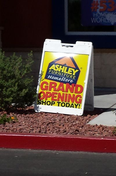 use advertising space in front business sidewalk signs
