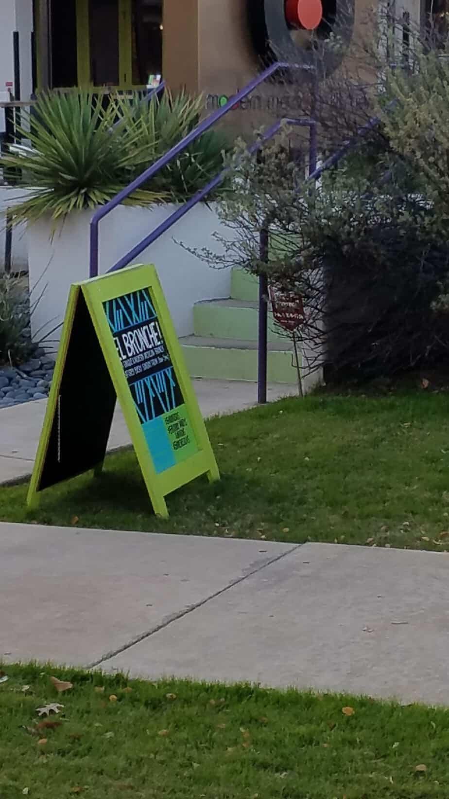 advertising examples sidewalk signs metal