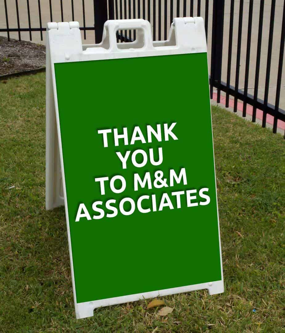 event sponsorship ideas green sidewalk sign.