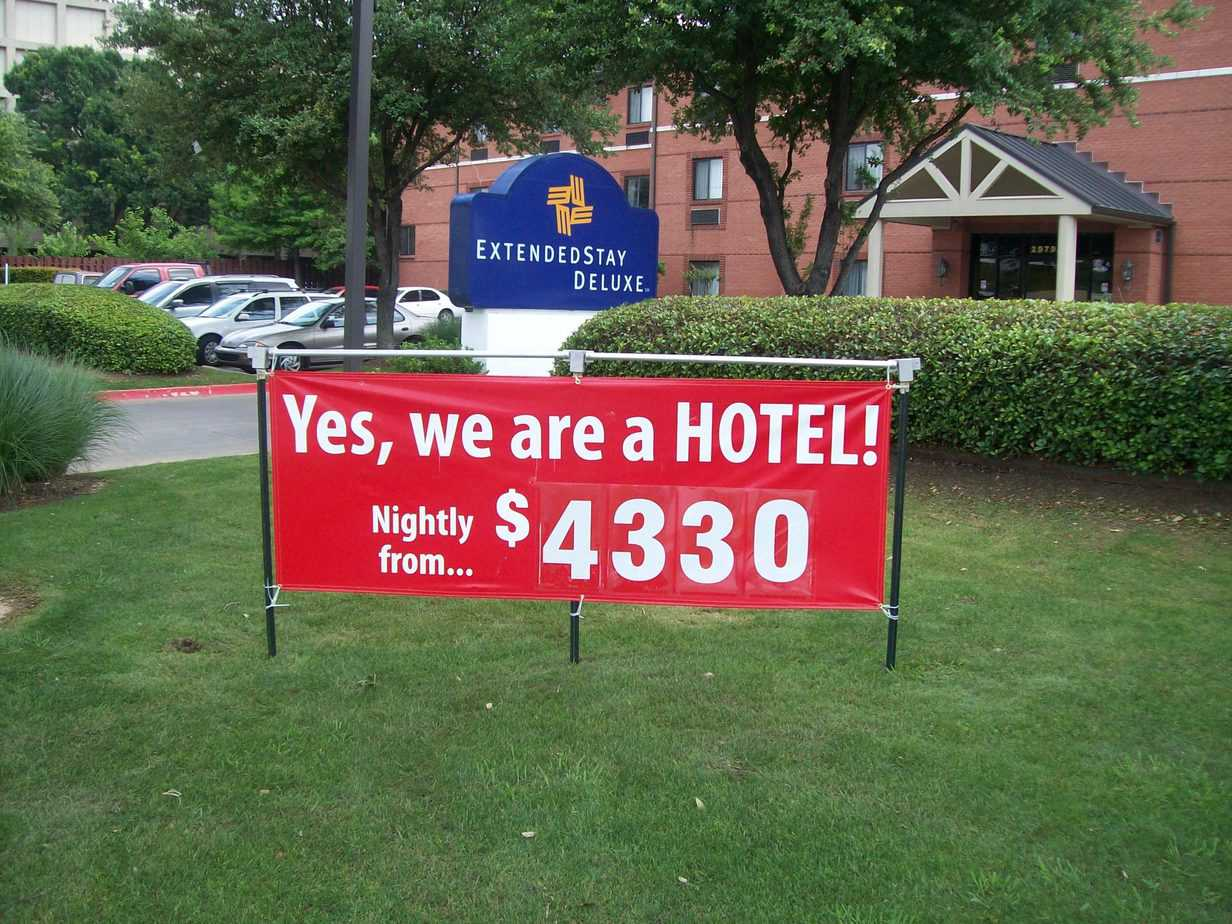 red banner advertising a special at a hotel