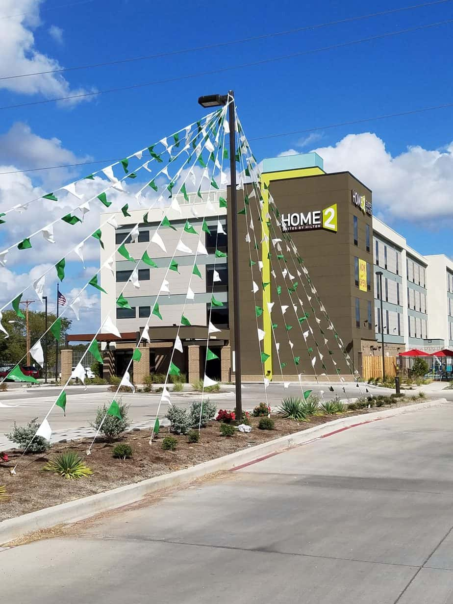 set of green and white pennants in front of a hotel
